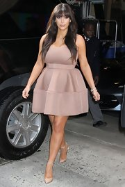 Kim Kardashian looked all dolled-up in NYC when she sported a pale pink dress with a full, pleated skirt.