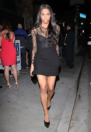 Ciara sizzled in towering black leather platform pumps during a night out on the town.