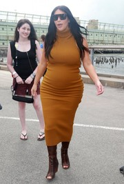 Kim Kardashian wrapped up her pregnancy curves in an ochre turtleneck dress by Laquan Smith for a day out in New York City.