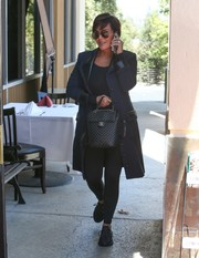 Kris Jenner grabbed lunch wearing a navy coat with black leather trim.