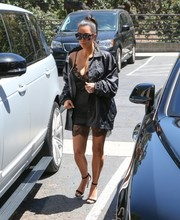 Kim Kardashian pulled her look together with a pair of black Manolo Blahnik Chaos sandals.
