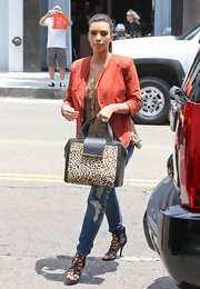 Kim Kardashian registered for her wedding carrying a leopard print tote that was trimmed in leather.