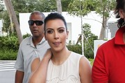 'Keeping Up With The Kardashians' star Kim Kardashian grabs lunch with her buddy Jonathan Cheban in Miami, Florida on December 4th, 2012.