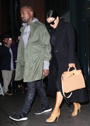 Kim Kardashian was classically stylish in a black wool coat while out and about in NYC.