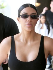 Kim Kardashian sported a severe center part while grabbing lunch in LA.
