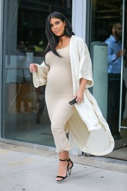 Kim Kardashian sheathed her baby bump in a body-con nude tank dress by Chriss Zoe for a day of shopping in New York.