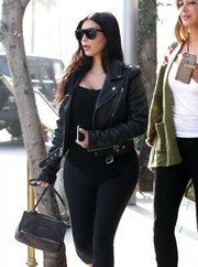 Kim Kardashian grabbed lunch in Beverly Hills carrying a Givenchy Croc-Embossed Mini Pandora Messenger.