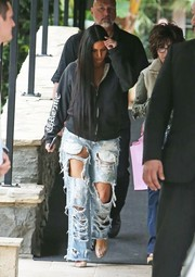 Kim Kardashian looked uncharacteristically toned-down in a loose black Chrome Hearts hoodie while out and about in Bel Air.