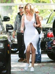 Khloe Kardashian was curvilicious in a tight white tank dress while grabbing lunch in Calabasas.