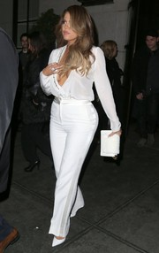 Khloe Kardashian's shapely hips were also on show in a pair of white side-stripe slacks, also by Mugler.