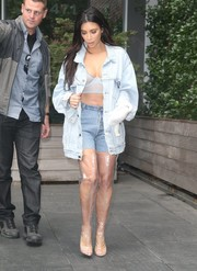 Kim Kardashian was hard to ignore in her oversized denim jacket (from hubby Kanye's Pablo merchandise) layered over a see-through bra while out and about in New York City.
