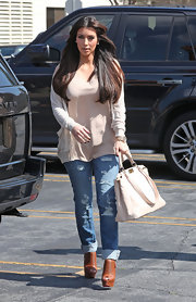 Kim Kardashian ran errands in cognac leather Futura platform peep toe booties.