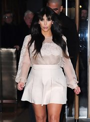 Kim Kardashian stopped by the 'Good Morning America Studios' with this silk chiffon blouse with woven floral lace detailing.