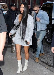 Kim Kardashian headed out in New York City wearing an oversized striped jacket by Jacquemus and not much else.