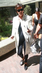 Kris Jenner bundled up in a white trenchcoat for a trip to the doctor's office.