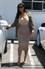 Kim Kardashian sported her signature monochromatic-chic style with this nude pencil skirt and tank top combo while visiting a studio in Van Nuys.