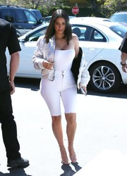 Kim Kardashian topped off her monochromatic outfit with a trendy bomber jacket.