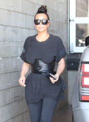 Kim Kardashian's black corset belt did a fine job of accentuating her tiny waist!