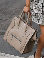 Kourtney Kardashian kept her accessories neutral with her nude Celine bag.