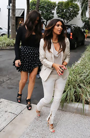 Kim Kardashian stuck to her light look with these strappy nude heels.