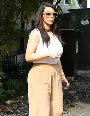 Kim Kardashian shielded herself from the Miami sunshine in a pair of oversized nude plastic shades.