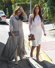 To complement the colorless palette of her ensemble, Kim accessorized with this elegant, neutral crossbody bag.