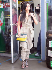 Kim stepped out in Hollywood wearing a tan jumpsuit and gladiator heels.
