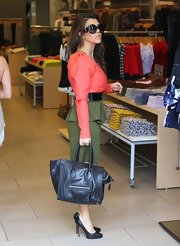 Kourtney Kardashian carried a black Celine tote on a shopping trip in Miami.