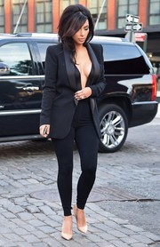 Kim Kardashian was almost spilling out of her low-cut black catsuit while she headed out to dinner.