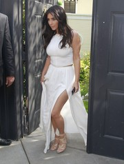 Nude triple-buckle strappy sandals by Tom Ford sealed off Kim Kardashian's look.