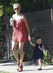Kimberly Stewart kept her look summertime cool with this red, star-print frock.