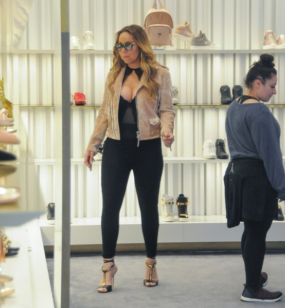 Black T-strap sandals with gold hardware finished off Mariah Carey's look.