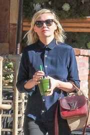 Kirsten Dunst kept the sun out with a pair of Oliver Peoples wayfarers while strolling.