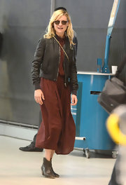 Kirsten's booties were a wise choice to stay comfy but still look cute on a busy day (aka flying across the Atlantic).