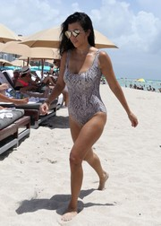Kourtney Kardashian showed off her beach body in a snakeskin-sprint one-piece by Norma Kamali.