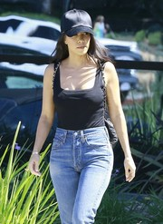 Kourtney Kardashian kept the sun out with a black satin baseball cap as she left a studio in Calabasas.