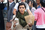 Kourtney Kardashian, wearing Mackage's Stricker Jacket, and Scott Disick grab some coffee and pastries from Starbucks in Tribeca, New York City, NY.