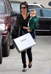 Kourtney Kardashian looked polished in a pair of timeless black ballet flats.