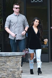 Kourtney Kardashian bundled up in a chic AS by DF velvet wrap blazer for a visit to a Los Angeles studio.