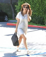 Kourtney Kardashian chose a basic free-flowing white t-shirt style dress for her daytime look while out in LA.