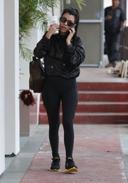 Kourtney Kardashian continued the athletic vibe with a pair of black leggings.