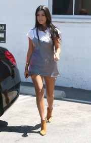 Kourtney Kardashian visited a studio in Van Nuys wearing a gray satin cami over a white tee.