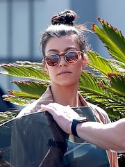 Kourtney Kardashian finished off her look with a pair of round sunglasses.