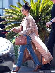 Kourtney Kardashian styled her outfit with a pair of brown suede pumps by Gianvito Rossi.