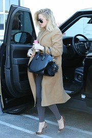 Khloe Kardashian bundled up in style in a tan wool coat by Haider Ackermann for a day out in Van Nuys.