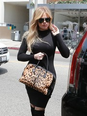 Khloe Kardashian hid her eyes behind a pair of Porsche aviators while filming her reality show.