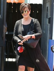 Kris Jenner stepped out of a Van Nuys studio carrying a quilted black leather bag.