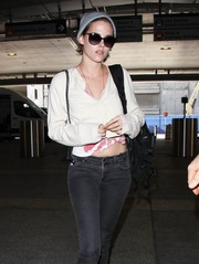 Kristen Stewart accessorized with a pair of chic butterfly sunnies.
