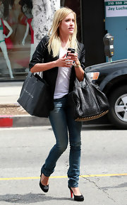 Reality star Kristin Cavallari was seen leaving the Alice and Olivia store sporting the coveted Rocco bag while making her way to her car.