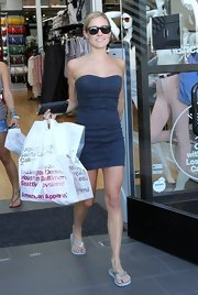 Kristin got her fashion fix while wearing a fitted, strapless denim dress and flip flops.